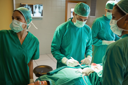 Team of surgeons working on the stomach of a patient in an operating theater