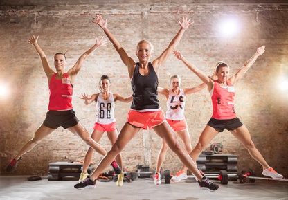 Sporty women doing jumping exercise